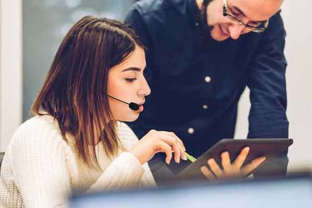 technical support people with tablet and headset
